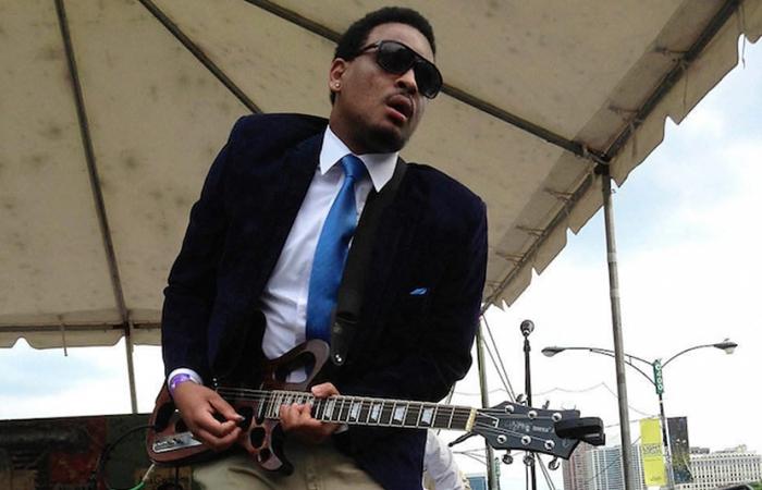 Jarekus Singleton Playing Guitar On Outdoor Stage