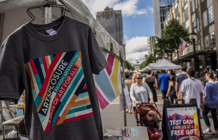 Photo Of A 2016 Artsplosure T-Shirt Hanging On A Vendor Tent