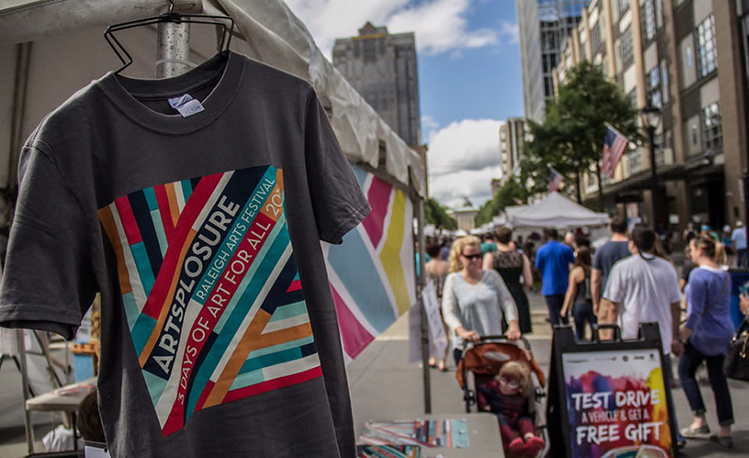 Photo Of A 2016 Artsplosure T-Shirt Hanging On A Vendor Tent