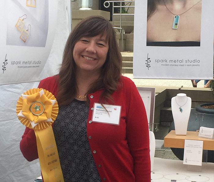 Kathleen Dawtel holding her award