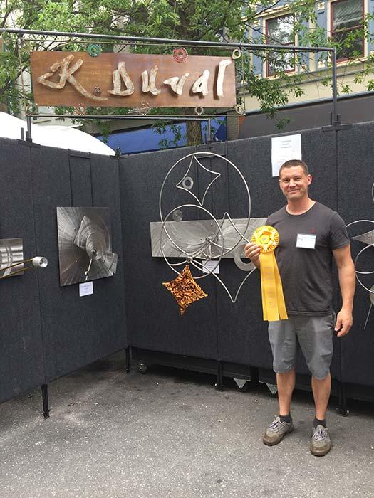 Kevin Duval holding Merit Award