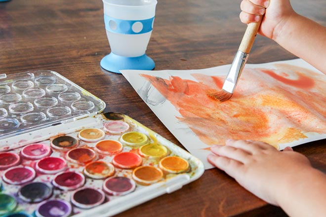 Child doing a water color painting