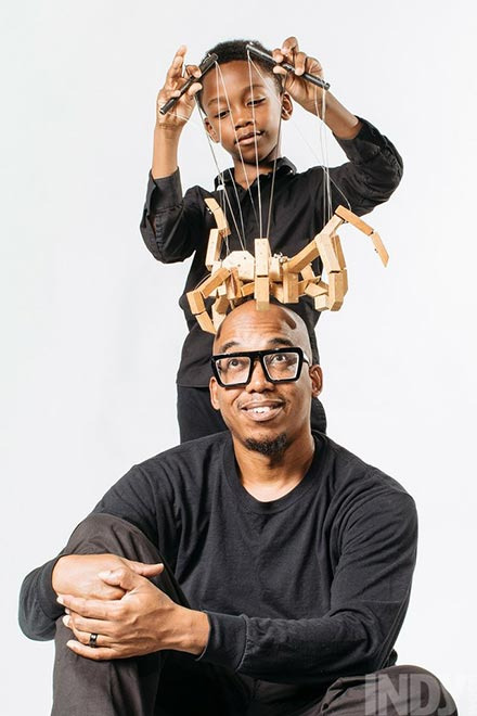 Tarin Pipkins with a child using a marionette on his head
