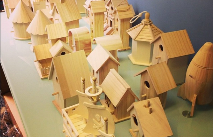 Wooden Birdhouses On A Table