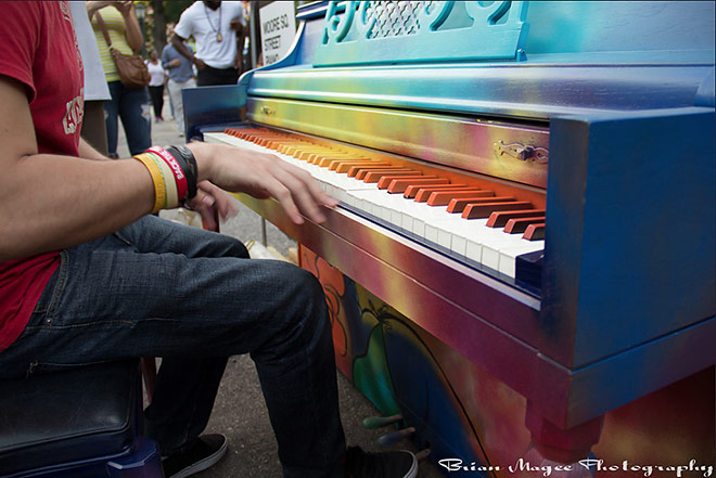 Person Playing The Street Piano