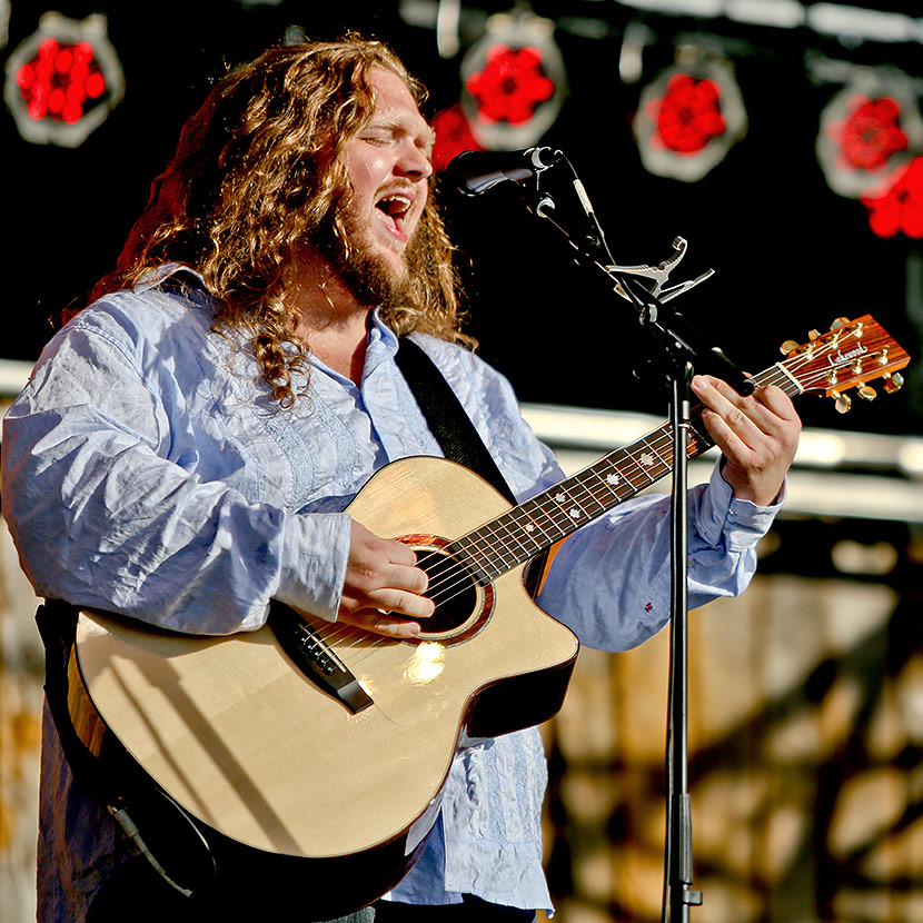 Matt Andersen playing guitar and singing on stage