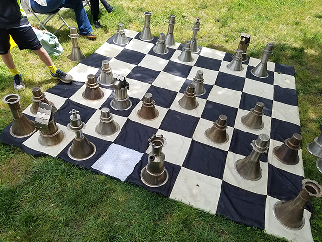 Over-sized chess game set out on the grass