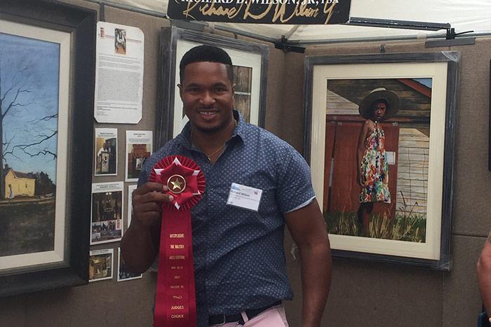 Richard Wilson holding his award