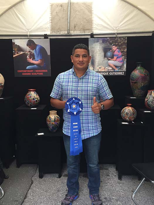 Luis Enrique Gutierrez holding Best In Show award