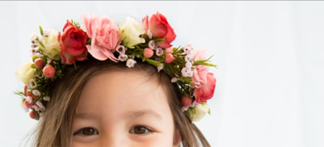 Top of a girl's head wearing a crown of flowers